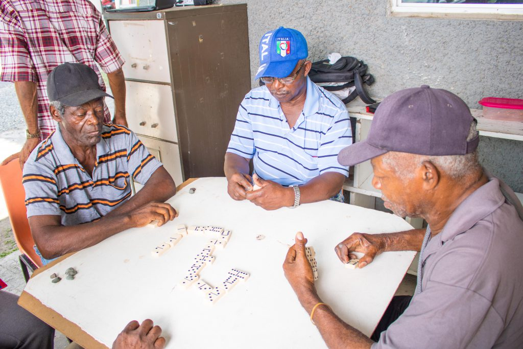 Seniors engaged in a Domino Tournament at the NCSC Head Office in Kingston